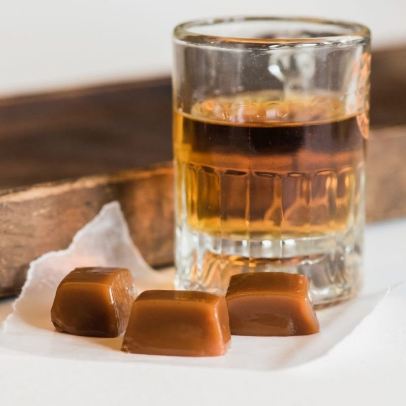 Hand-Crafted caramel squares with the glass of drink